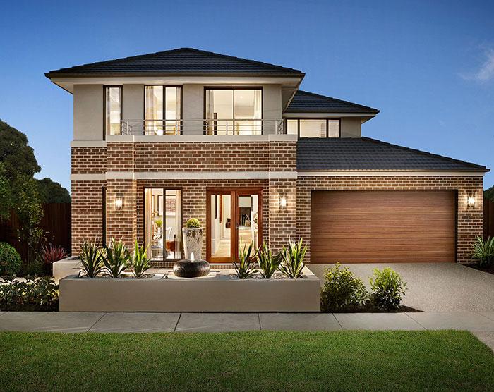 Mặt tiền nhà sử dụng gạch ốp tường cùng tông màu với cửa tạo cảm giác hài hòa, thống nhất